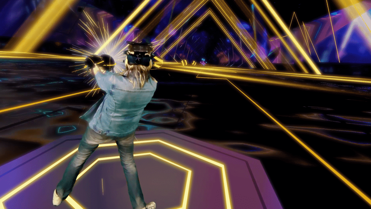 Person playing Synth Riders on the Oculus Quest.